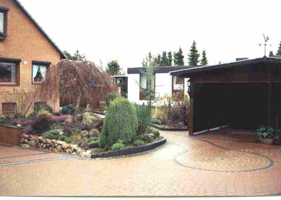 Natursteinmauer und Pflasterarbeiten